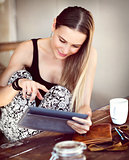 Pretty girl using tablet