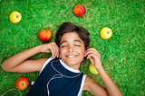 Cheerful boy listening to music