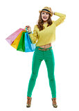 Excited woman with shopping bags looking aside, white background