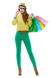 Woman with shopping bags talking smartphone on white background