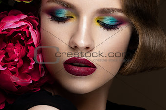 Beautiful girl with colorful make-up, flowers, retro hairstyle. beauty face.