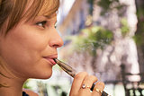 Young Woman Smokes E-Cig Electronic Cigarette