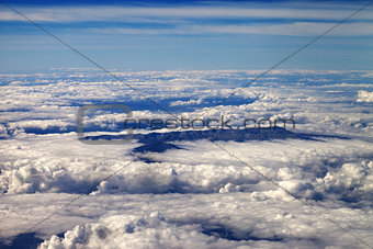 Top view on clouds and mountains