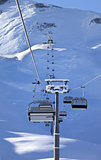 Chair-lift at early morning after snowfall