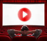 online cinema screen with play media button in center