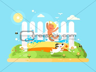 Little boy in garden pool having fun