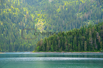 Beautiful Black Lake, Green Forest and Beautiful Mountains in the Morning. National Park Durmitor, Montenegro