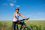 girl rides a bicycle in the countryside
