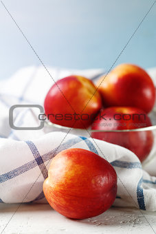 Five Fresh Nectarines on Blue Background