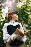 Woman in Vintage Clothes Reading Book