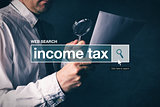 Web search bar glossary term - income tax