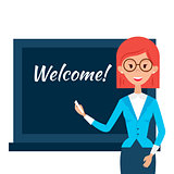 School Teacher with Welcome Word over Chalkboard