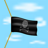 Pirate flag with skull symbol hanging on rope on blue sky