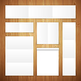 Set of White Banners on Wooden Surface
