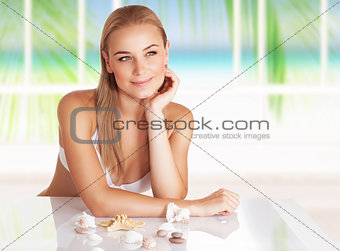 Beautiful woman at beach house