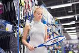 Woman shopping sports equipment in sportswear store.