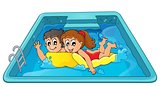 Children on floating mattress in pool