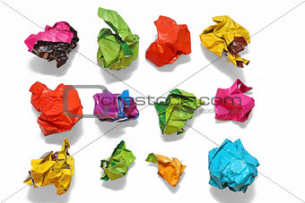 Crumpled color paper folded in a row
