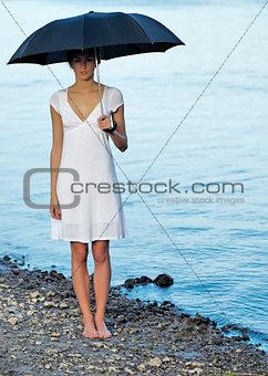 Attractive woman under umbrella