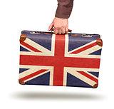 Male hand holding vintage Union Jack suitcase