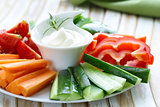 fresh vegetables snack - carrots, sweet pepper, cucumbers and tomatoes with dip