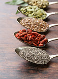 healthy eating ingredients super food - chia and flax seeds, goji berries, nuts