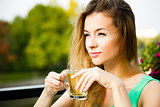 Young Woman Drinking Green Tea Outdoors