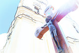 Jesus on wooden cross in a background of church with glimpse sunshine