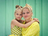 Two blondes Mom and daughter smiling, hugging