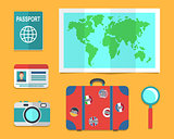 Travelers suitcase, earth map, passports