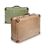 Two vintage suitcases isolated