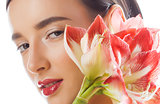 young pretty brunette woman with red flower amaryllis close up isolated on white background. Fancy fashion makeup, bright lipstick, creative Ombre manicured nails