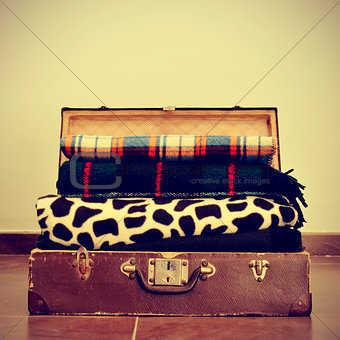blankets in an old suitcase