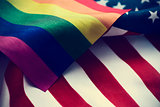 gay pride flag and American flag