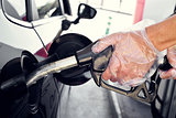 filling the fuel tank of a car