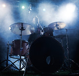 Silhouette drummer on stage.