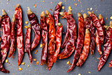 Dried red chili peppers on slate background Top view Copy space