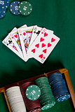 Cards with poker hand with chips