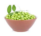 Fresh organic green pea with leaf in ceramics plate