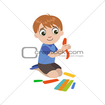 Boy Preparing The Putty For Craft
