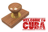 Red rubber stamp with welcome to Cuba