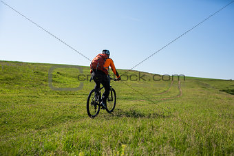 Cyclist on the Beautiful Meadow Trail