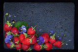 Fresh ripe strawberry on dark background, top view, copy space