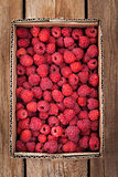 Fresh organic ripe raspberry in box