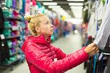 Woman shopping sportswear in sports store.