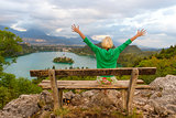 Woman enjoying panoramic view of Lake Bled, Slovenia.
