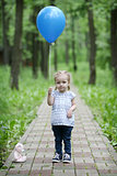 Little girl with blue balloon
