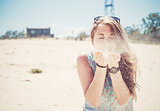 Girl blowing sand