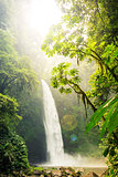 Tropical waterfall & flowing river