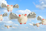 Piggy banks flying free in sky